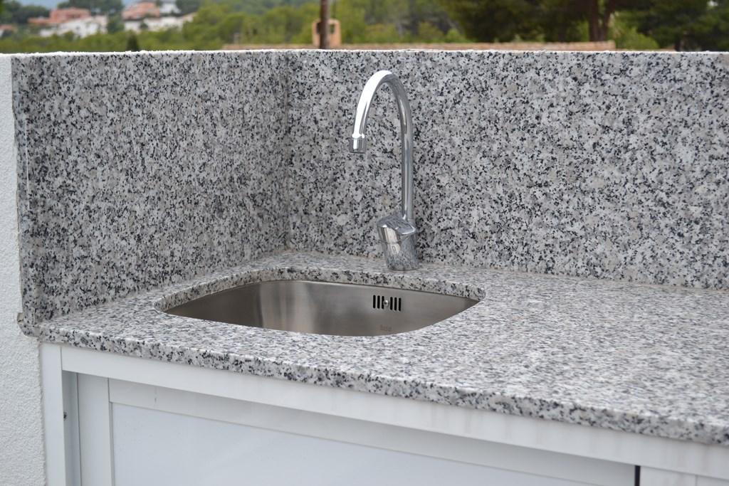 Encimera granito blanco perla cauvells for Encimeras de granito baratas